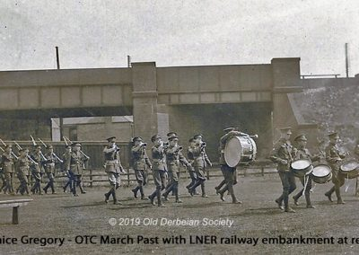 Janice Gregory - OTC march past with LNER railway embankment behind on Parker's Piece